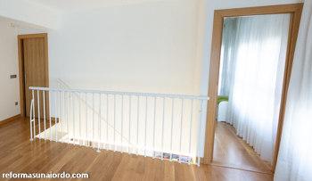 Reforma integral duplex en Amorebieta - Escalera acceso piso inferior